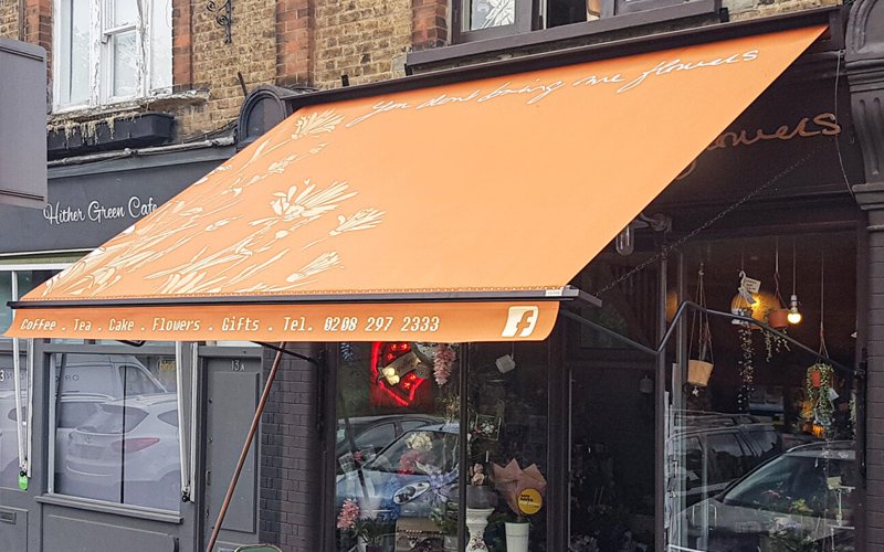 orange cafe awnings by Deans