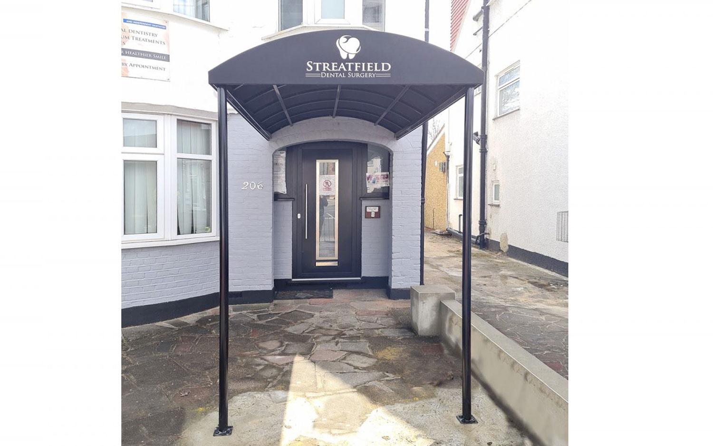 Bull-nose entrance canopy for dentist in Harrow, London